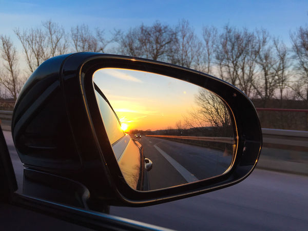 driving mirror Driving Mirror Road Sunlight Car Car Driving Driving Around Driving Mirror Mirror Mode Of Transport No People Outdoors Reflection Road Road Trip Side-view Mirror Sky Sun Sundown Sunset Sunshine Transportation Tree Vehicle Vehicle Mirror