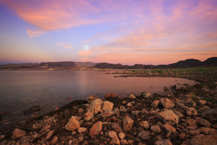 Moonrise over Lake Mead, Nevada at Boulder Beach Lake Shore Moon Sunset Water Lake Mead Nature Travel Landscapes Canonphotography Nevada Nevadaisbeautiful Nature Lovers Scenic USA Fine Art Beautiful Landscapes Lake Mead National Recreation Area Landscapes With WhiteWall Moon Rise Moonlight Skies On Fire Pink Sky Pink Sunset The KIOMI Collection
