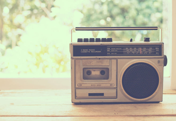 vintage radio on table nature background, instagram filter Technology Retro Styled Radio Music No People Arts Culture And Entertainment Focus On Foreground Close-up Communication Equipment Analog Day Audio Equipment Indoors  Old Vintage Photography Themes Antique 60s Style