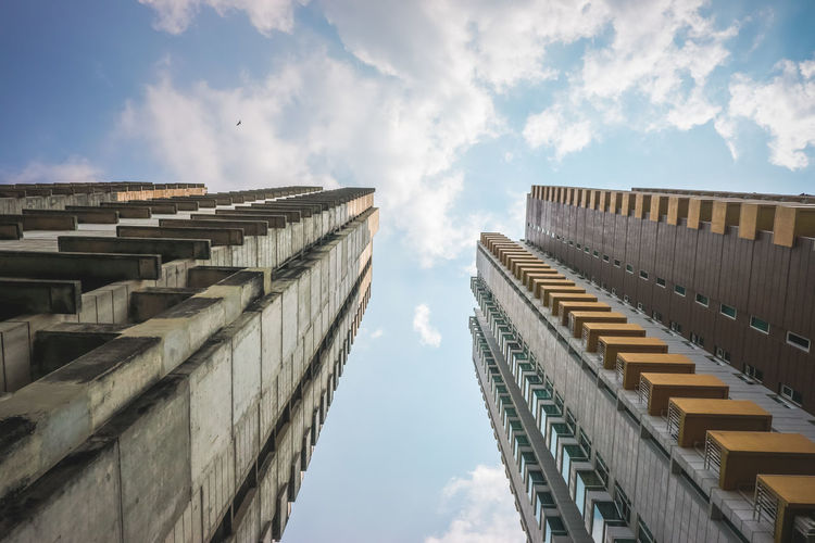 Abandoned building and a living condominium. Abandoned Achitecture Building Clouds Design Engineering Exterior Grunge High Model Old Outdoors Rise Sky Vintage