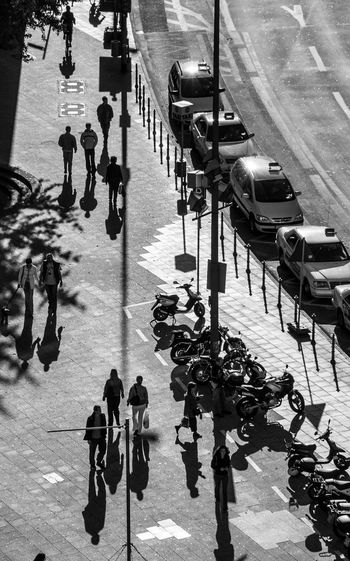 High angle view of people walking on sidewalk in city
