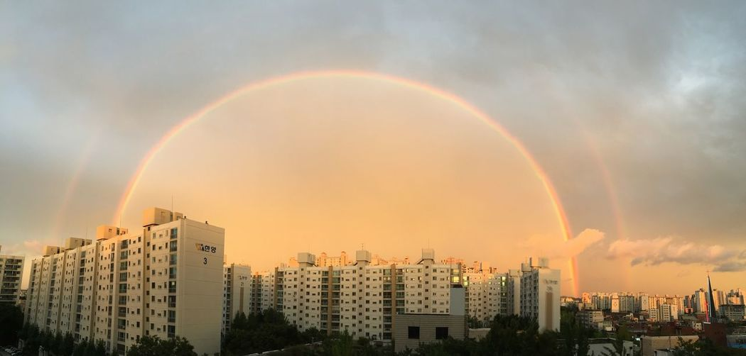 Rainbow Over City