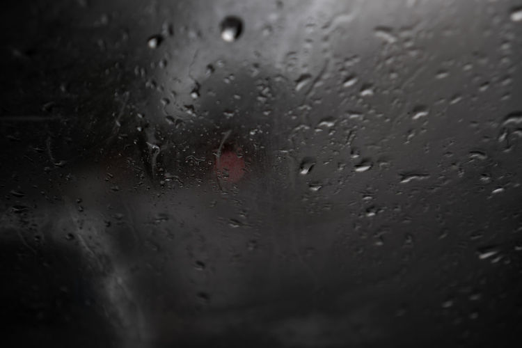 Drop Wet Water Rain Window Glass - Material Transparent Car Full Frame Nature Transportation Close-up Motor Vehicle Mode Of Transportation No People Indoors  Vehicle Interior Backgrounds Rainy Season RainDrop Glass Abstract Background Texture
