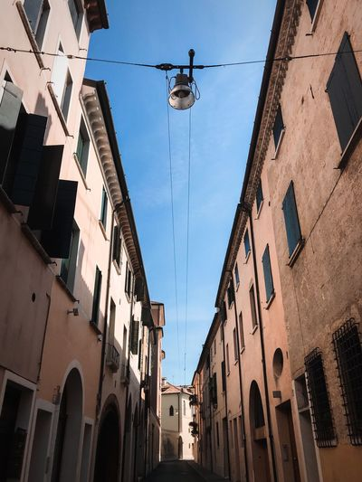 ShotOnIphone Treviso Architecture Building Exterior Built Structure Sky Low Angle View Building Lighting Equipment Outdoors Nature City Street Light Residential District Day Cable No People Hanging Sunlight Window Clear Sky Street