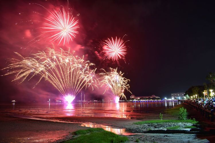 Night Firework Motion Illuminated Firework Display Celebration Exploding Water Arts Culture And Entertainment Long Exposure Event Nature Firework - Man Made Object Sky Architecture Glowing No People Blurred Motion River Light Outdoors Sparks