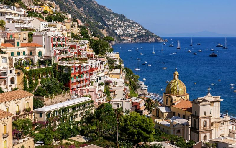 Positano architecture Travel Famous Places Majolica Tiles Cliffside Southern Italy Holiday Destination Province Of Salerno Travel Destinations Amalfi Coast Urban Scene Village Italy EyeEm Selects Bella Italia EyeEm Gallery Holidays Seaside Seascape Water Tree Sea Beach Clear Sky Place Of Worship Sky Architecture TOWNSCAPE Coastline Rocky Coastline Housing Settlement