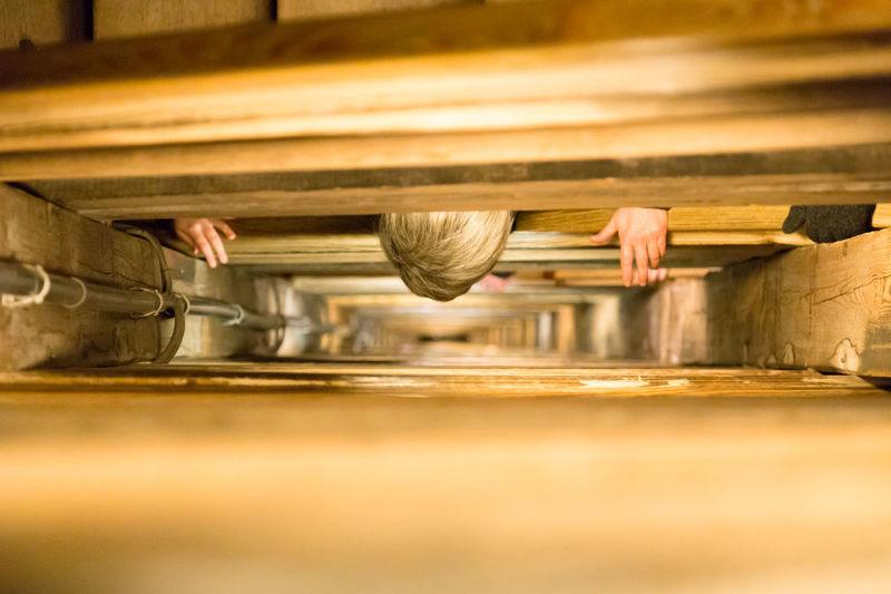 Person peeking by railing