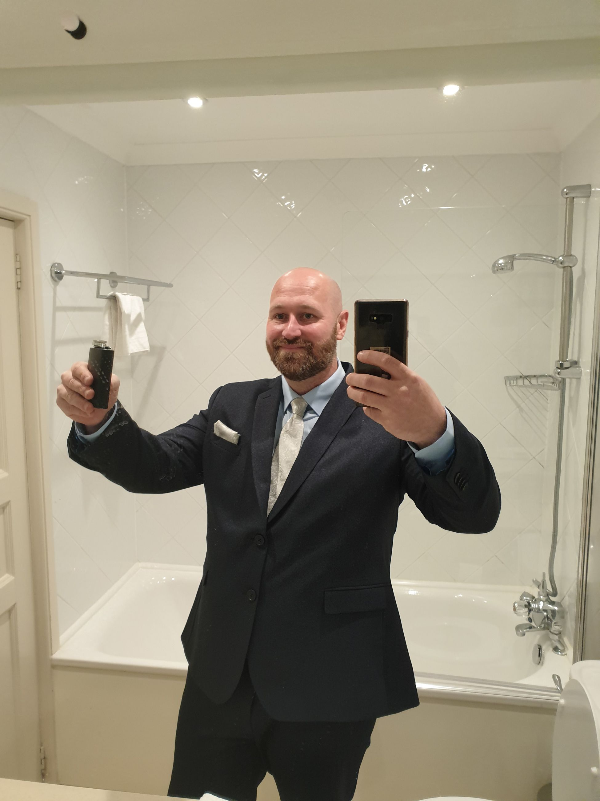 one person, males, standing, front view, bathroom, men, indoors, holding, adult, real people, mirror, mobile phone, home, business, communication, technology, reflection, mature men, domestic bathroom, mature adult, wireless technology