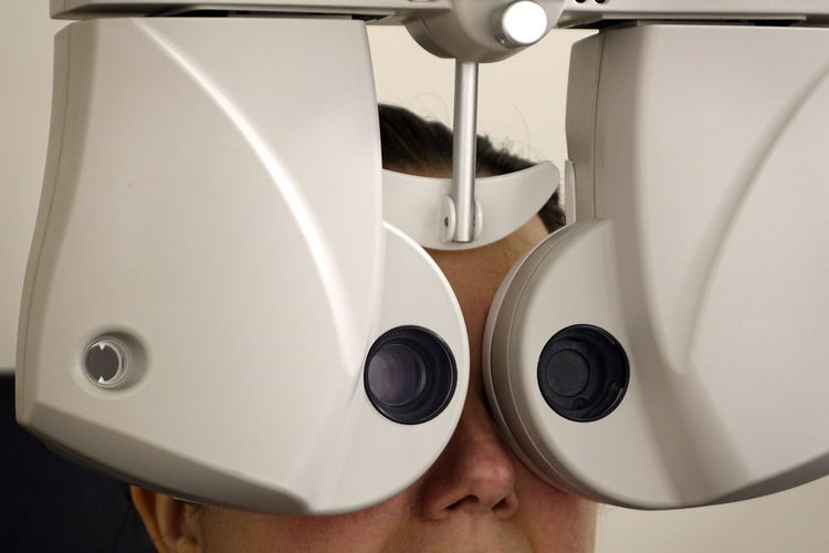 Close-up of woman with eye test equipment