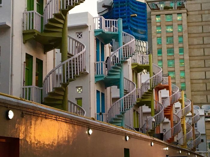 Colorful spiral staircase in Singapore. Spiral Staircase Spiral Stairs Colours Stairs_collection Stairs Geometry Cityscapes Old And New Architecture Architectural Feature Buildings Old And Modern Showcase: February Lines & Curves Lines And Curves Color Palette