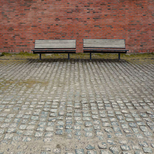 Bench Brick Wall Cobblestone No People Pair Sidebyside Together Two The Street Photographer The Street Photographer - 2017 EyeEm Awards