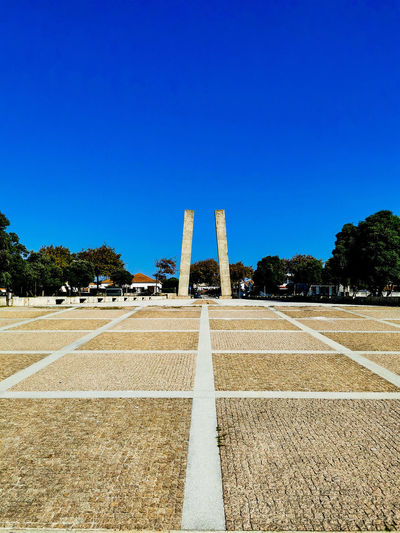 View of monument against clear blue sky