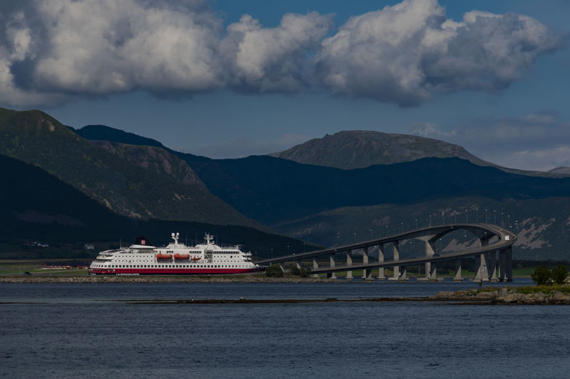 Hurtigruten on the way - North Norway Mountain Cloud - Sky Water Sky Transportation Nautical Vessel Mountain Range Mode Of Transportation Architecture Waterfront Sea Nature Scenics - Nature Built Structure Ship No People Day Beauty In Nature Outdoors Passenger Craft Cruise Ship North Norway Travel Wanderlust Betterlandscapes My Best Photo Stay Out The Great Outdoors - 2019 EyeEm Awards The Traveler - 2019 EyeEm Awards