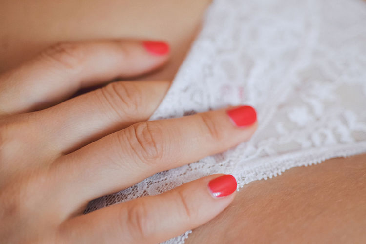 Close-up of woman hand with red tattoo