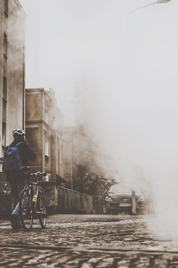 Bicycle Mode Of Transport Transportation Land Vehicle Travel Real People Cycling Lifestyles Riding Outdoors Men One Person Building Exterior City Day EyeEm Best Edits The Week On Eyem EyeEm Best Shots EyeEm Gallery VSCO Moody Fog Foggy The Street Photographer - 2017 EyeEm Awards Live For The Story Paint The Town Yellow