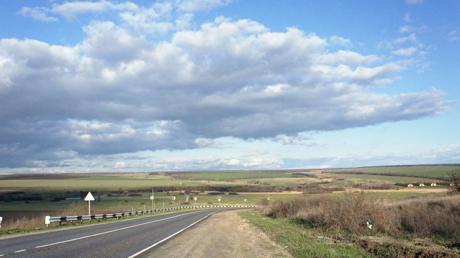 Lost In The Landscape чистое небо без войны Cloud - Sky Beauty In Nature Road The Way Forward Highway Landscape Transportation Outdoors Sky Day Scenics Nature Travel Destinations Grass No People Water Perspectives On Nature