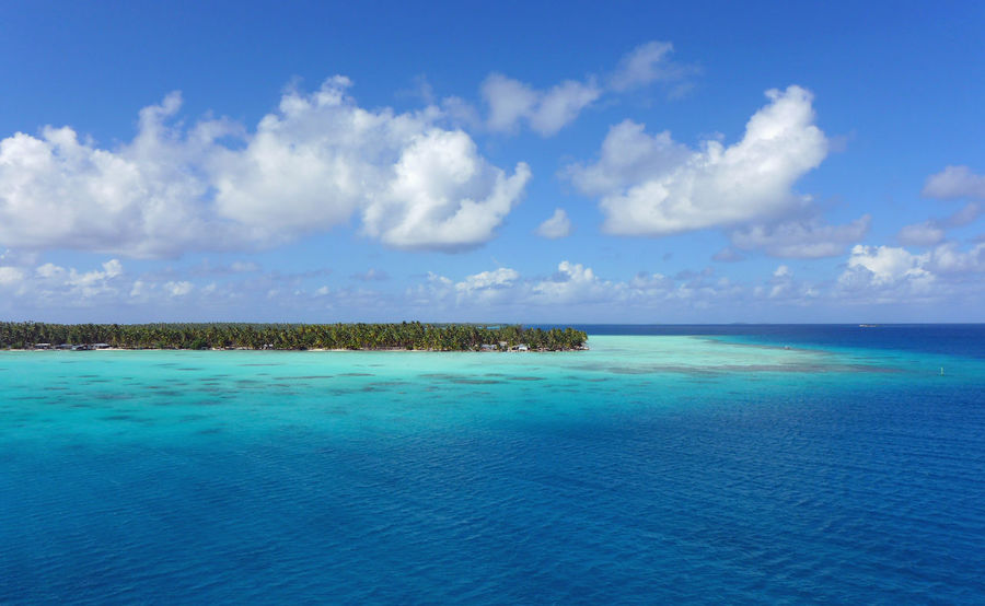 Arial Shot Atoll Blue Water Blue Sky Clouds And Sky French Polynesia Kauhei South Sea Tuamotu