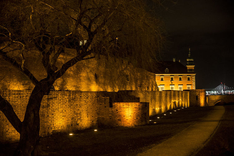 Old and new Night Lights Old And New Poland Warsaw Old Town Warsaw Poland Zamek Królewski Architecture Bare Tree Bridge Building Building Exterior Built Structure City Illuminated Mury Night Night View No People Outdoors Plant Stadion Narodowy Street Tree