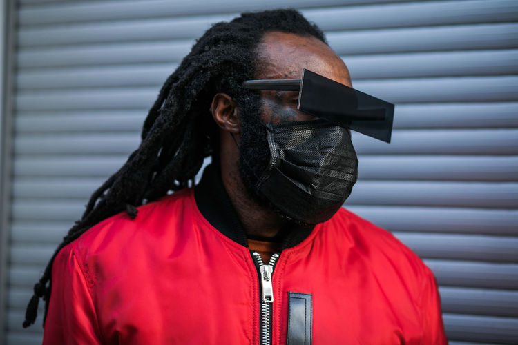 Stylish african man in black mask and glasses