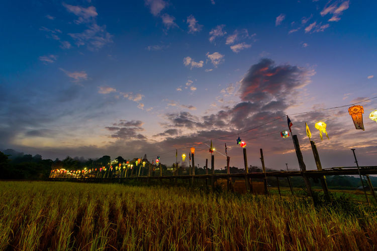 thai tradition on wooden bridge Morning Sun Wooden Bridge Nightphotography Thai Tradition Sunset Beauty Agriculture Tree Field Sky Landscape Cloud - Sky Panoramic