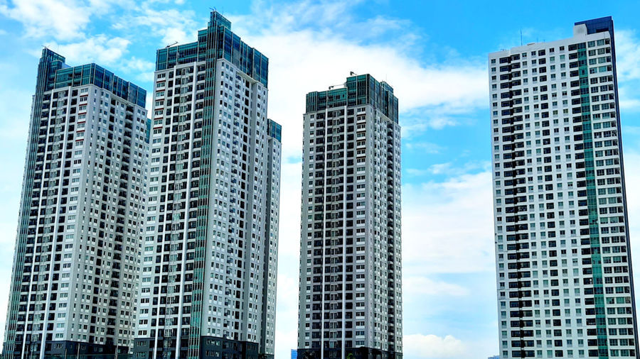 Low angle view of buildings against sky in city