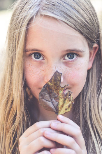 Fall Beauty Blond Hair Childhood Childhood Memories Close-up Day Fall Fall Leaves Freckles Front View Girls Headshot Lifestyles Looking At Camera One Person Outdoors People Portrait Real People Smiling