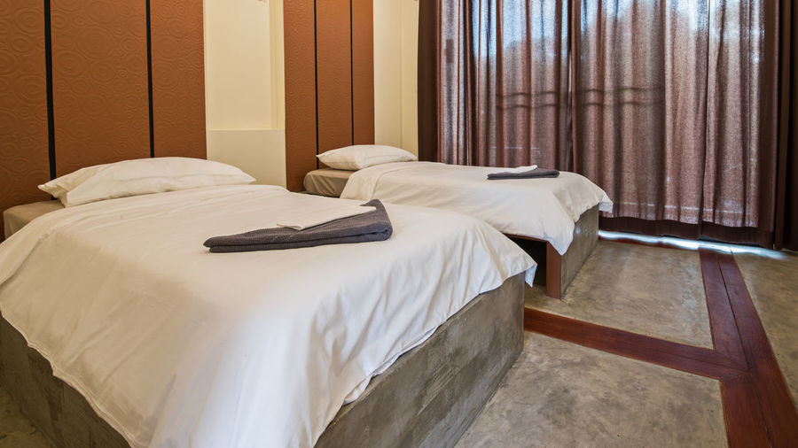 Empty bed of luxury hotel room