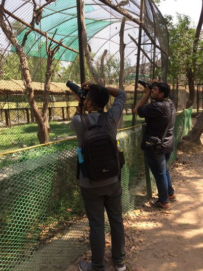 photographer in action Real People Full Length Men Child Lifestyles Nature Inner Power Males  Sunlight Togetherness Fence Day Boys Inner Power