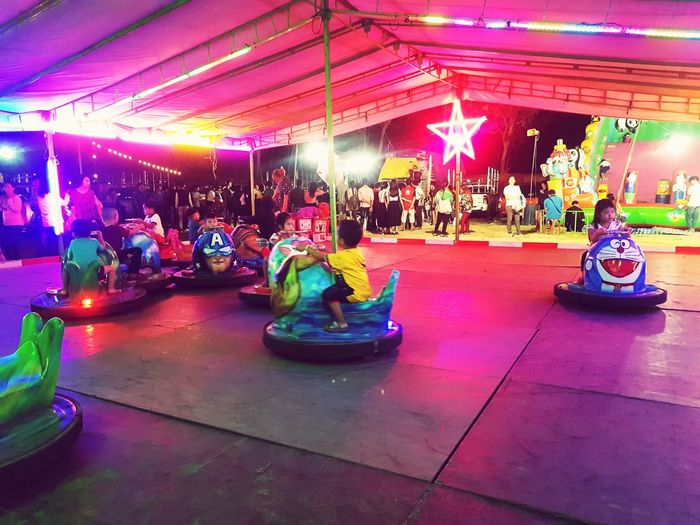 Arts Culture And Entertainment Illuminated Multi Colored Fun Night People Nightlife Carousel Indoors  Adult