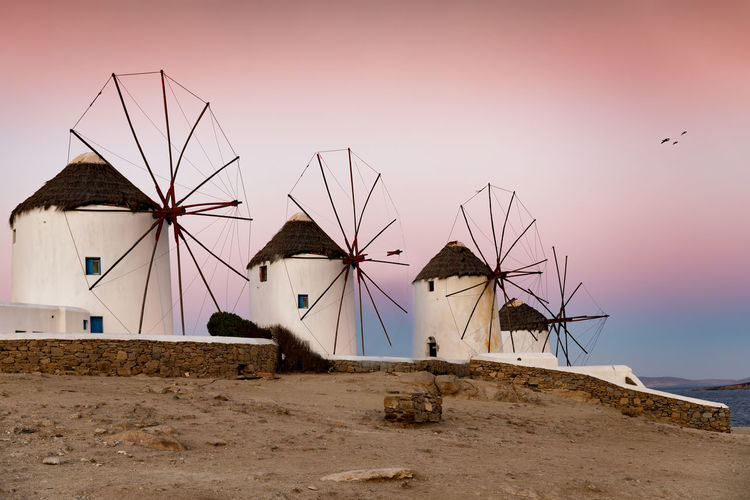 The famous windmills over the town of Mykonos island during daybreak, Cyclades, Greece Aegean Greek Mediterranean  Morning Tourist Attraction  Travel Windmills Architecture Built Structure Cyclades Dawn Europe Greece Island Landmark Mykonos No People Outdoors Sky Summer Sunrise Sunset Tourism Travel Destinations Wind Power