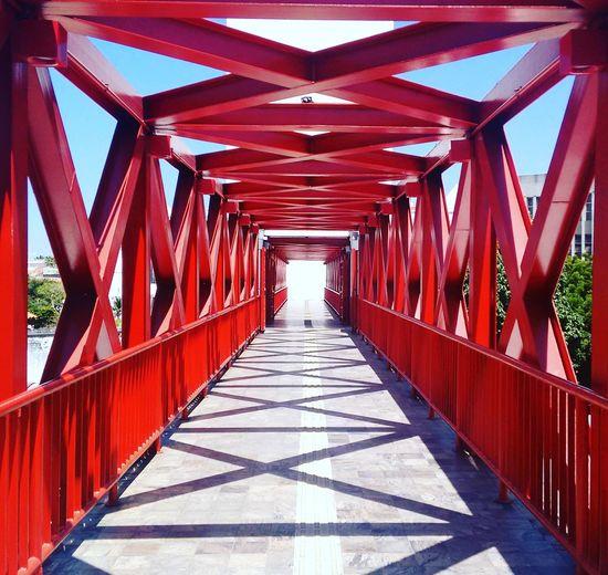 Empty Red Bridge Against Sky