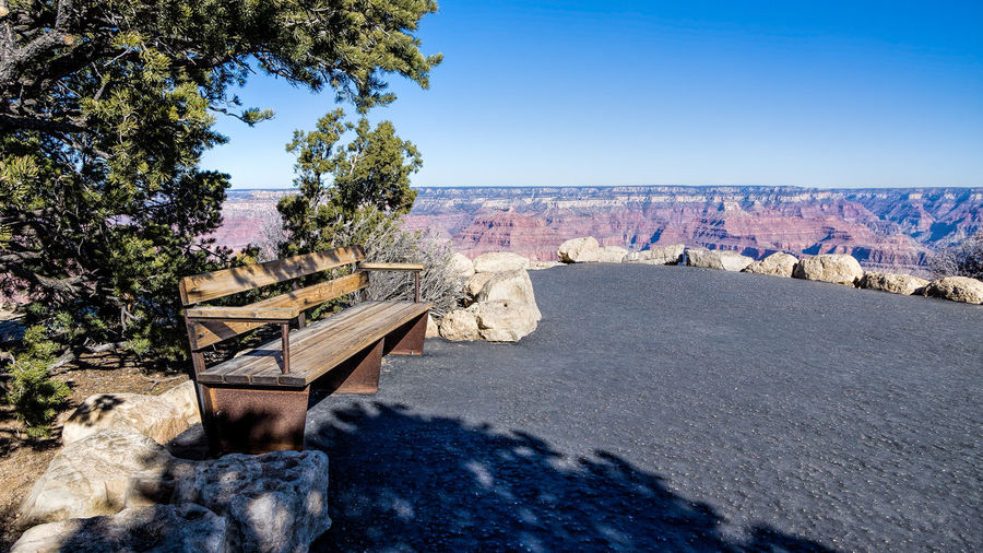Lonely Bench at the Grand Canyon Sky Tree Nature Plant Clear Sky Day Scenics - Nature No People Blue Solid Beauty In Nature Rock Tranquil Scene Water Rock - Object Tranquility Sunlight Transportation Outdoors Architecture
