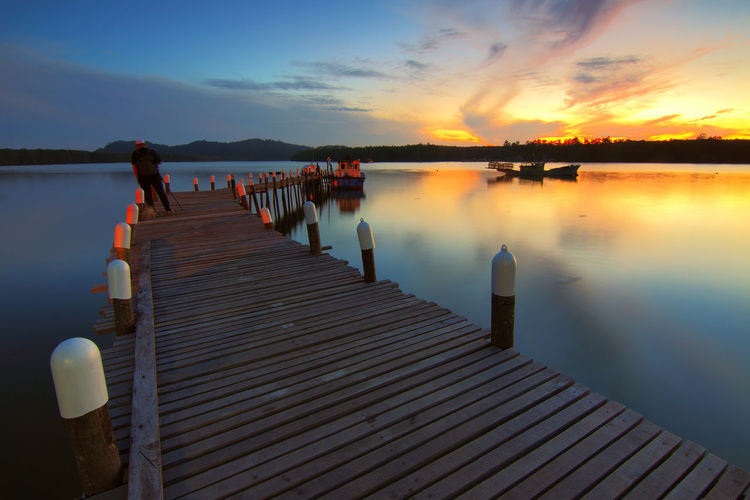Beauty In Nature Cloud - Sky Direction Idyllic Jetty Lake Nature Non-urban Scene Outdoors Pier Real People Reflection Scenics - Nature Sky Sunset The Way Forward Tranquil Scene Tranquility Water Wood - Material
