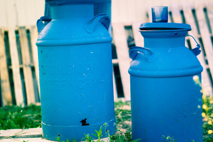 Close-up of blue canisters