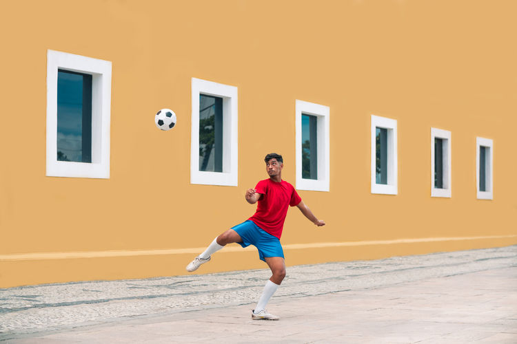 Man playing soccer in the Recife, Pernambuco, Brazil. Brazil Football Pernambuco Recife Russia Adult Exercising Full Length Kicking Leisure Activity Lifestyles Motion One Person Russian Soccer Soccer Ball Soccer Player Soccer Uniform Soccer⚽ Sport Street Streetphotography World Cup The Street Photographer - 2018 EyeEm Awards
