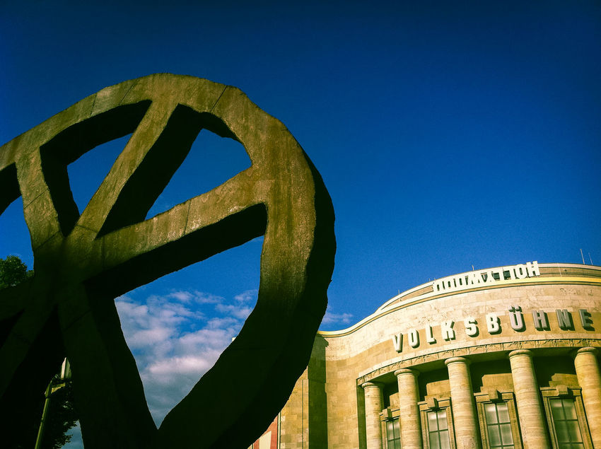 Volksbühne theater with sculpture Architecture Blue Sky Built Structure Circular Columns Culture History Outdoors Sculpture Theater Volksbühne Wheel