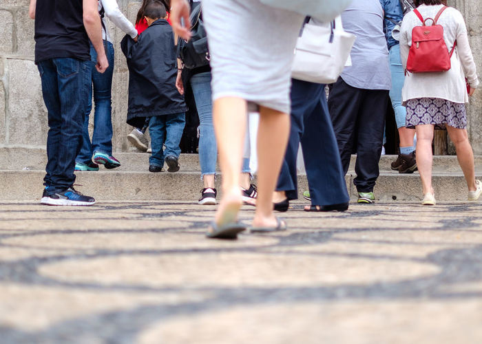 Group Of People Real People City Large Group Of People Women Human Leg Casual Clothing Crowd Selective Focus Day Walking Adult Motion Lifestyles Outdoors Jeans Legs Entrance Door