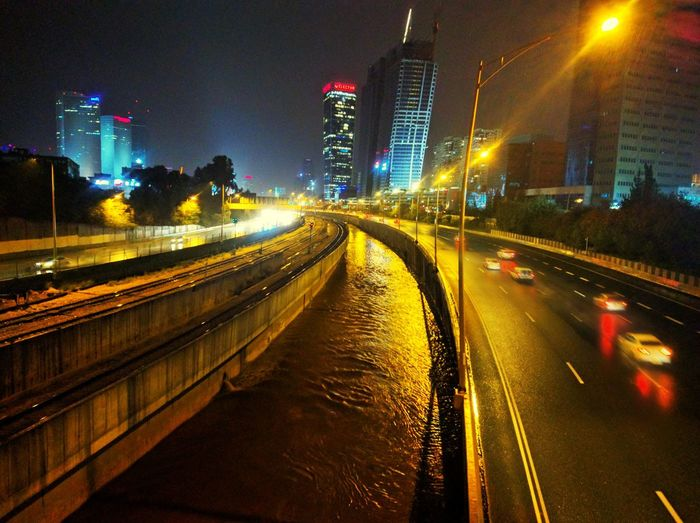 Ayalon River Neon Lights Night Illuminated Storm Rain No People Stormy Weather Bike Ride Light Trail Speed Motion Road Street Light Nightphotography Rainy Season Wet Street City Mobility In Mega Cities