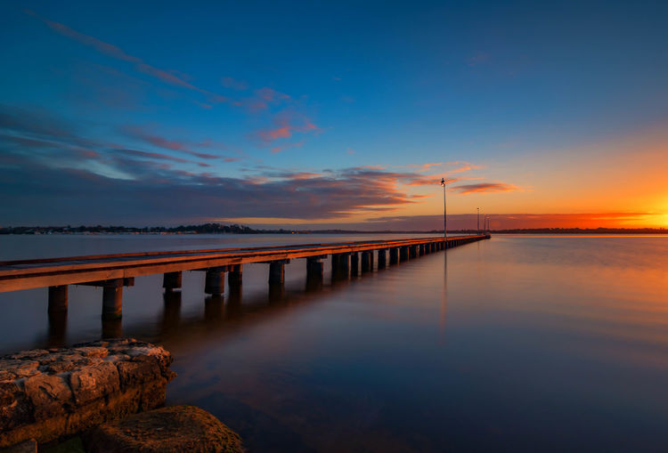 Lonely Jetty at Sunset Perth Australia Beauty In Nature Cloud - Sky Connection Idyllic Nature No People Orange Color Outdoors Pier Reflection Rock Rock - Object Scenics - Nature Sea Sky Solid Sunset Tranquil Scene Tranquility Water Wooden Post