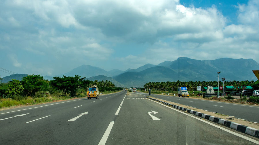 View of highway against cloudy sky