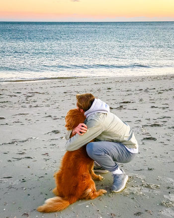 Best friends Friends Golden Retriever Hug Hugging A Tree Beach Beauty In Nature Best Friends Bonding Companion Companion Dog Companion Pet Companionship Dog Dog Love Domestic Animals Horizon Over Water Love Outdoors Pet Pets Real People Sea Togetherness Water Young Adult