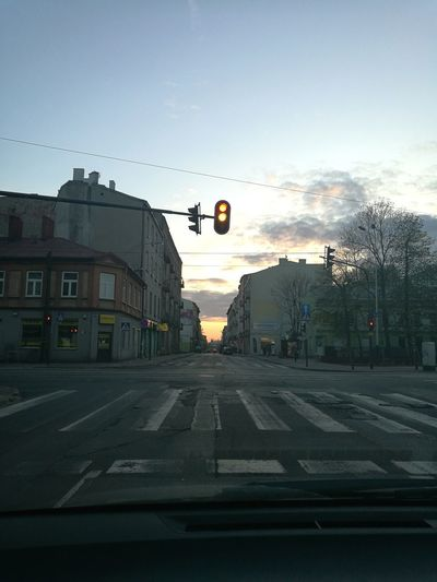 No People Transportation Outdoors Sky Road Sign Sunset Architecture City Day Architecture HuaweiP9 Illuminated City Street City Life Cityscape Polska Clouds & Sky Łódź Traffic Lights Crossing The Street Cross Roads Buildings Buildings & Sky Tenement Houses Tenements