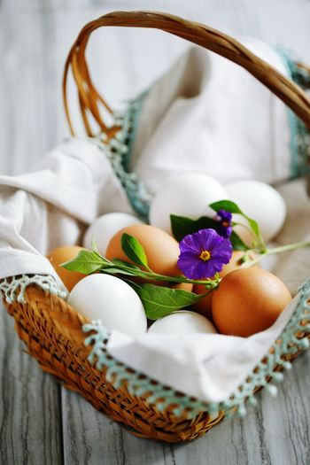 Close-up of eggs and flower in basket