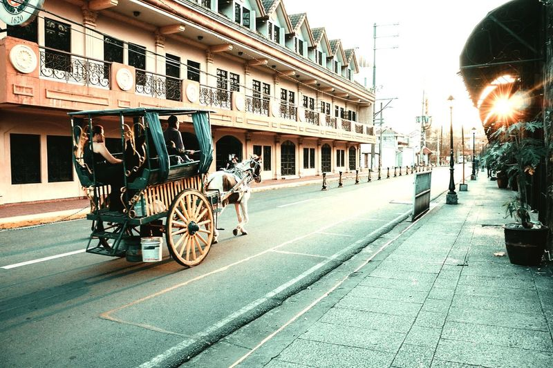 """Kalesa"" a traditional mode of transportation in the Philippines Way Oldtime Oldtimes Kalesa Kalesaride KalesaAdventure Intramuros Manila Philippines Tothesun Road City Road History Street Sky Architecture Building Exterior Built Structure Horsedrawn Carriage Horse Cart Horse EyeEmNewHere Inner Power"