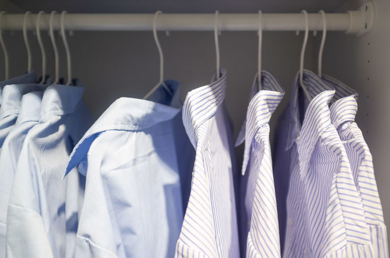 Close-Up Of Shirts Hanging On Clothes Rack