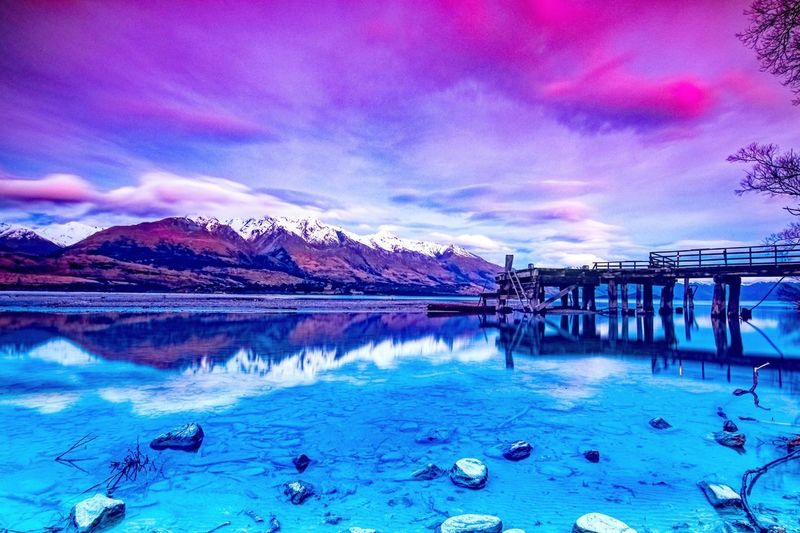 Beauty In Nature Blue Built Structure Cloud - Sky Idyllic Mountain Nature No People Outdoors Reflection Scenics - Nature Sea Sky Snowcapped Mountain Sunset Tranquil Scene Tranquility Water Waterfront