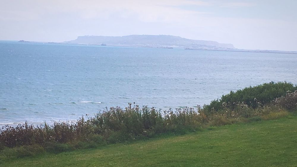 Beauty In Nature Grass Nature Tranquility Tranquil Scene Sea Scenics Water No People Outdoors Day Beach Landscape Plant Horizon Over Water Sky Mountain Travel Destinations Marram Grass Growth Bowleaze Weymouth Dorset Weymouth View Of Portland