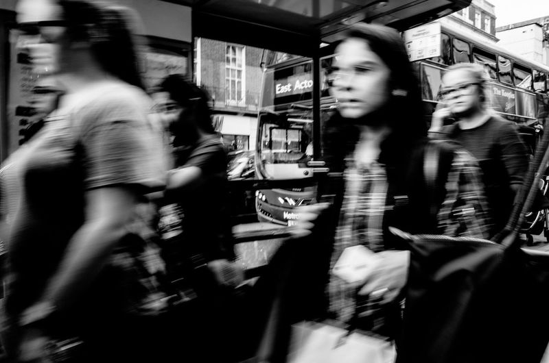 Blurred motion of woman walking in city