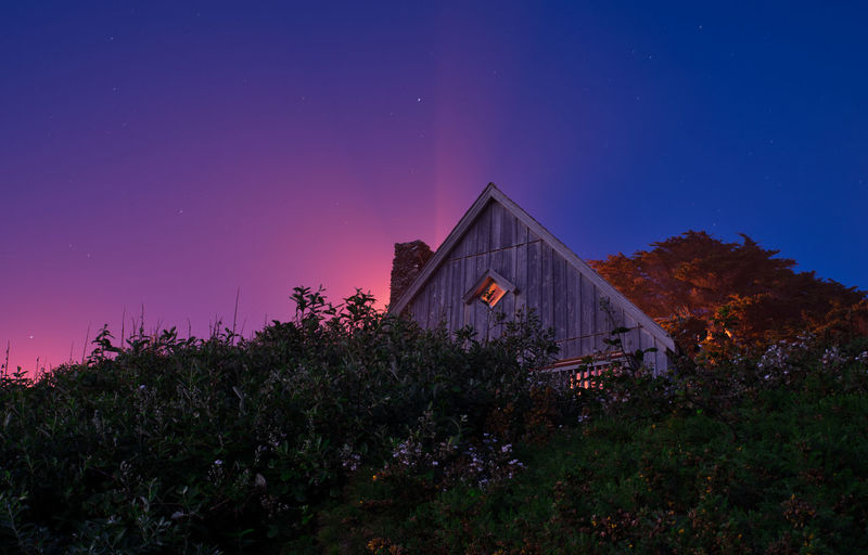 Wooden house at the Oregon Coast with night sky Night Lights Nightphotography Architecture Astronomy Beauty In Nature Building Building Exterior Built Structure Coast Growth House Illuminated Land Nature Night Night Sky No People Plant Purple Scenics - Nature Sky Skyporn Space Star - Space Tree
