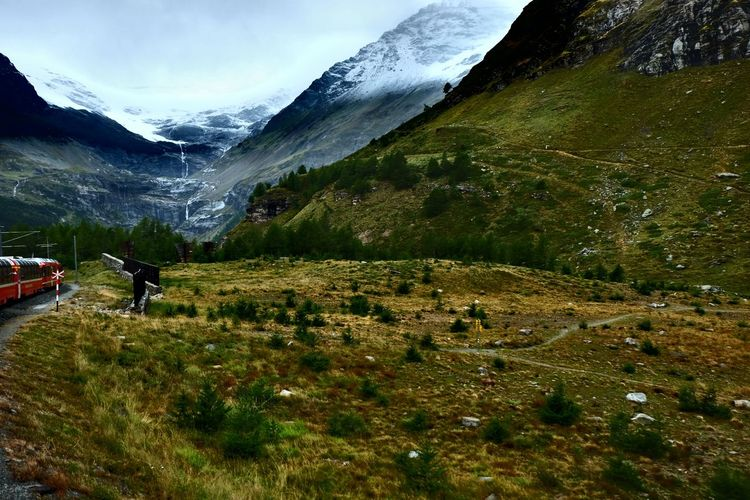 Bernina Express Activity Adventure Beauty In Nature Day Environment Hiking Landscape Leisure Activity Lifestyles Men Mountain Mountain Range Nature Non-urban Scene One Person Outdoors Real People Scenics - Nature Sky Train Tranquil Scene Tranquility